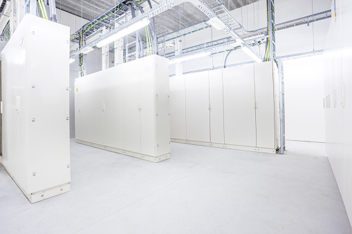 in the basement of an industrial building there is an room with electrical cabinetsin the basement of an industrial building there is an room with electrical cabinets