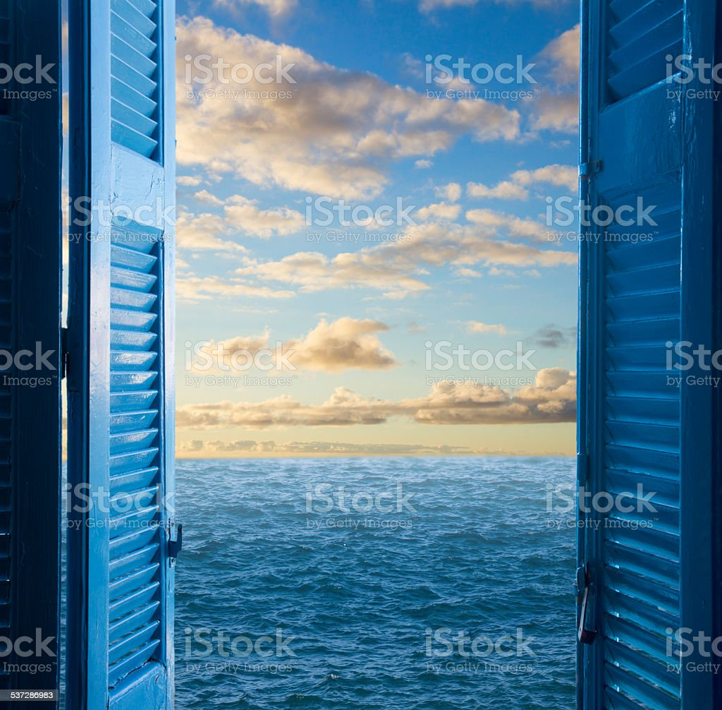 room with open door  to seascape stock photo