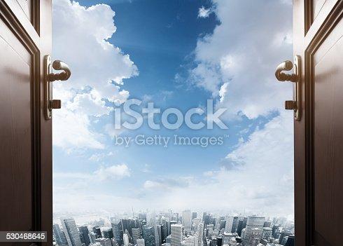 istock room with open door to the city 530468645