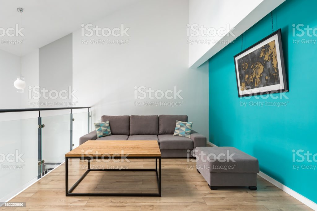 Room with turquoise wall stock photo