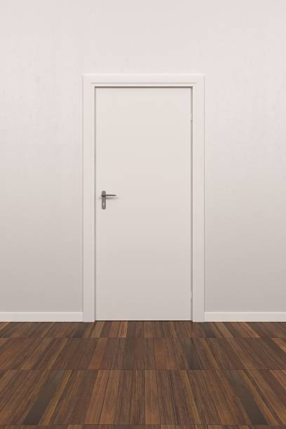 Room with white door and wall and brown floor stock photo