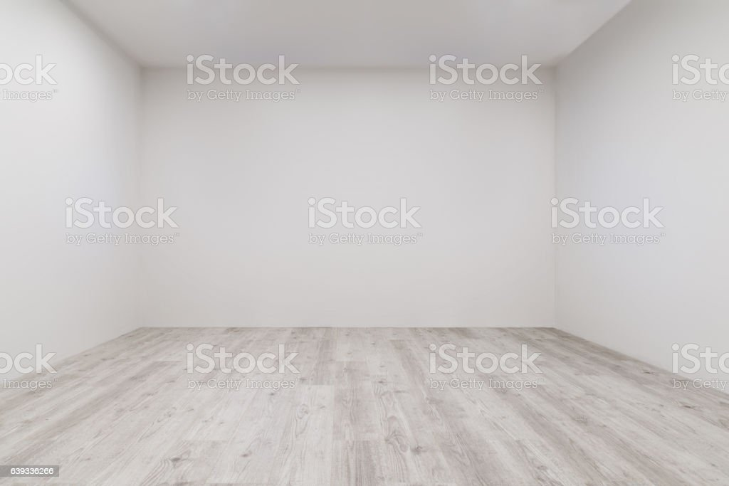 Room with whitewashed laminate and newly painted wall stock photo