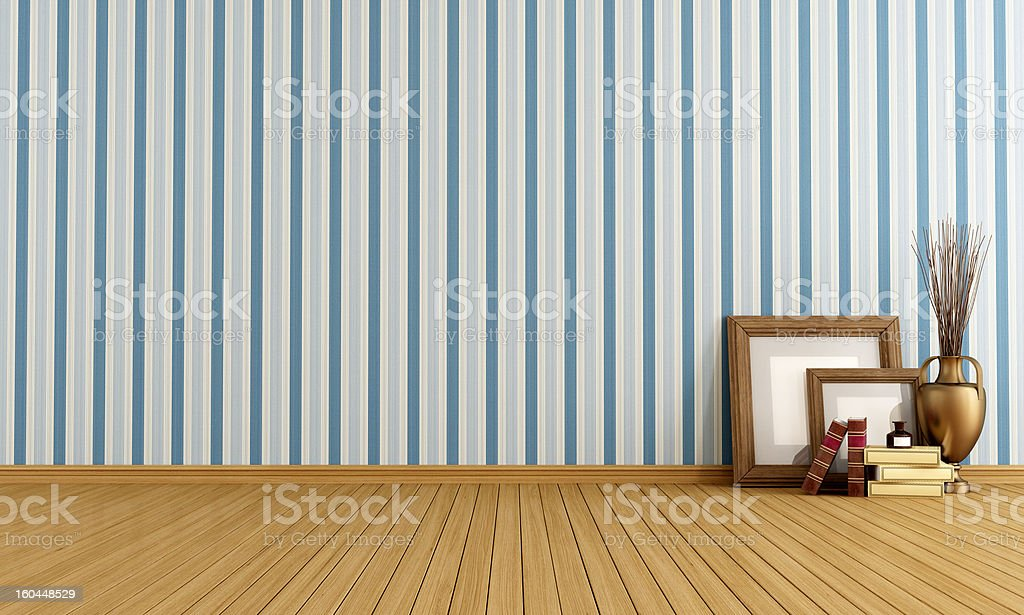 Room with wooden floors, striped wallpaper and few items royalty-free stock photo