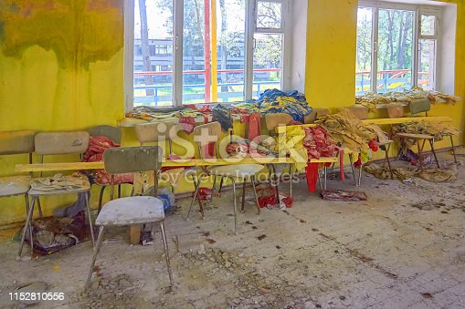 Room with yellow walls in an abandoned children's camp. Soviet pioneer camp in Ukraine.
