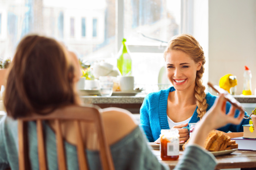 Roommates Eating Breakfast Stock Photo - Download Image Now