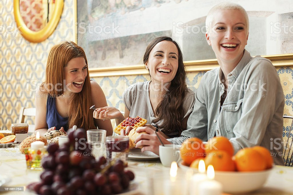 Roommates enjoying a meal together stock photo