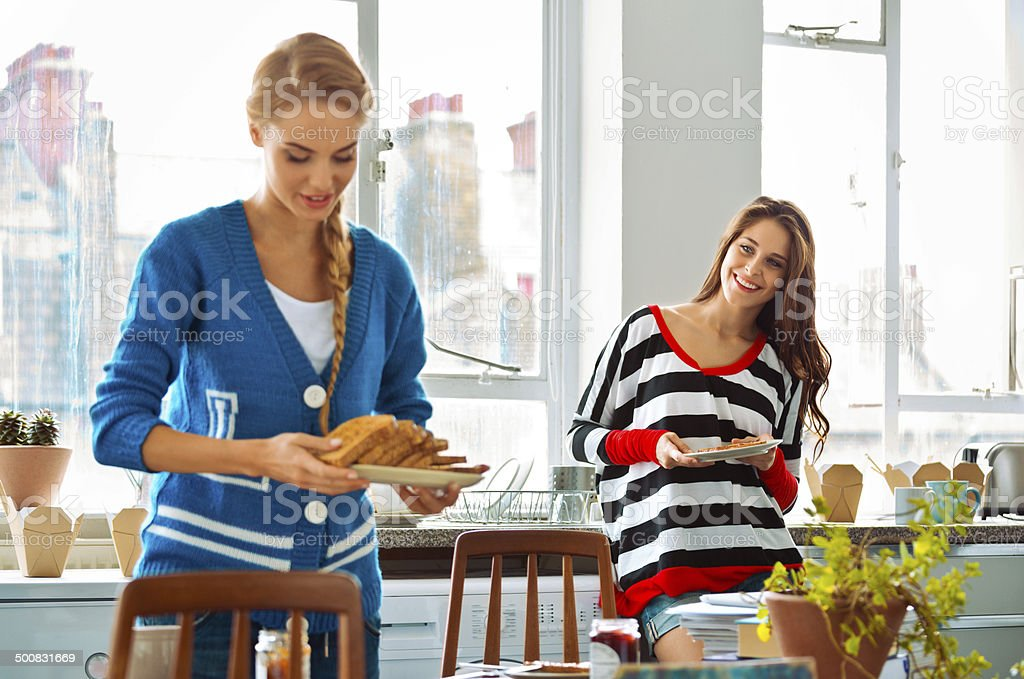 Roommates in the morning Cheerful female roommates geeting ready to breakfast. 20-24 Years Stock Photo