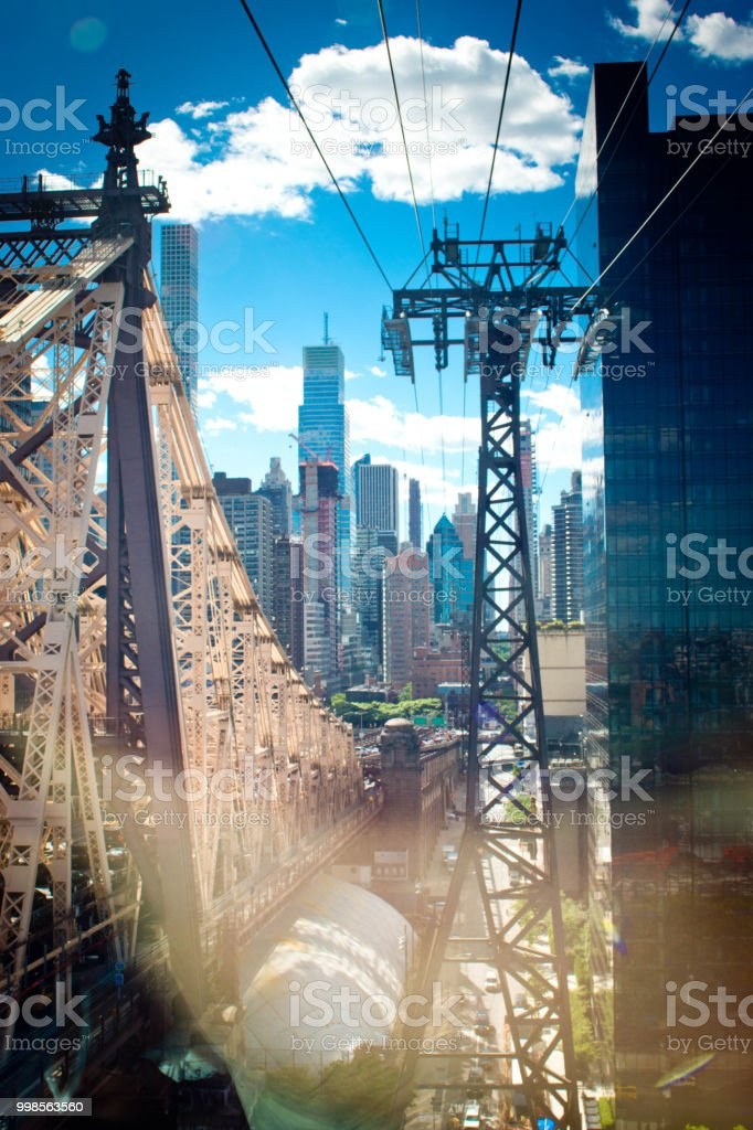 Roosevelt island tramway cable supports with the Queensboro Bridge on...