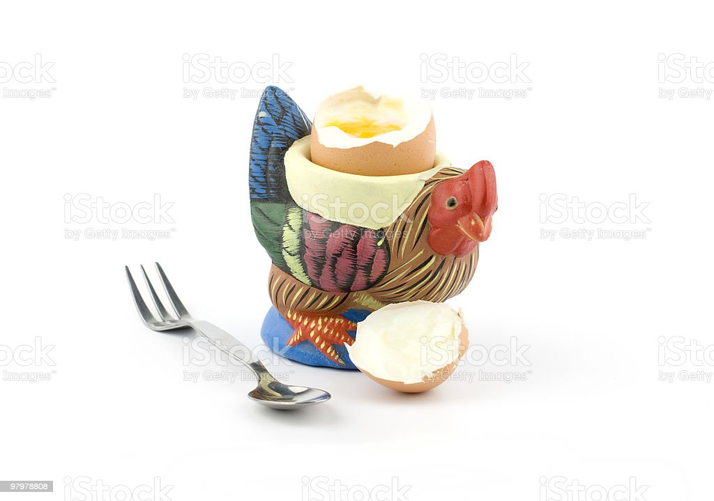 Rooster shaped eggcup with a boiled egg royalty-free stock photo