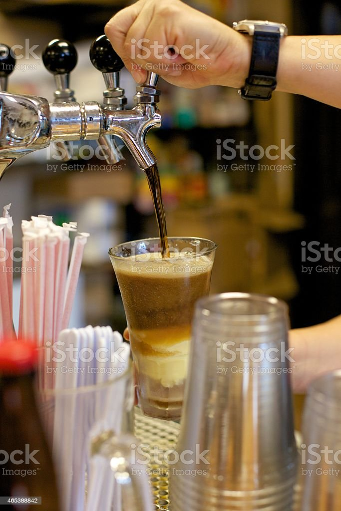 Root Beer Float being poured on counter stock photo