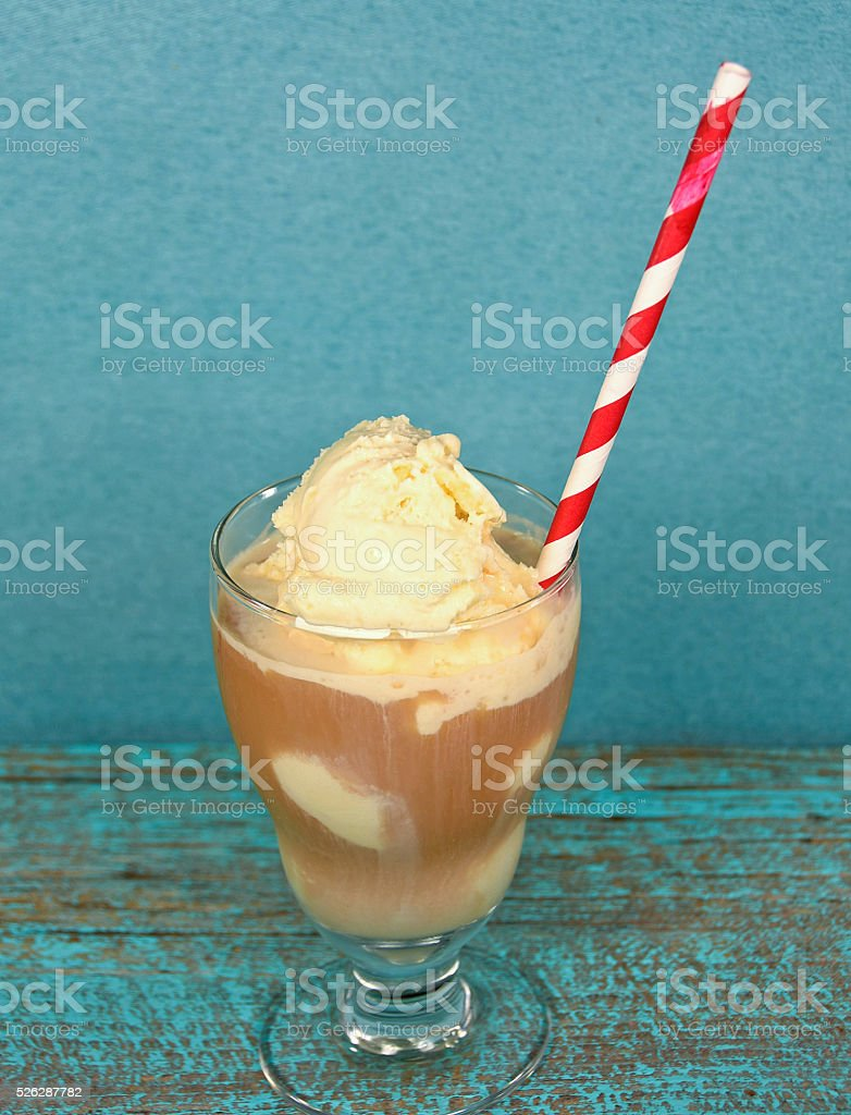 root beer float with red and white striped straw stock photo