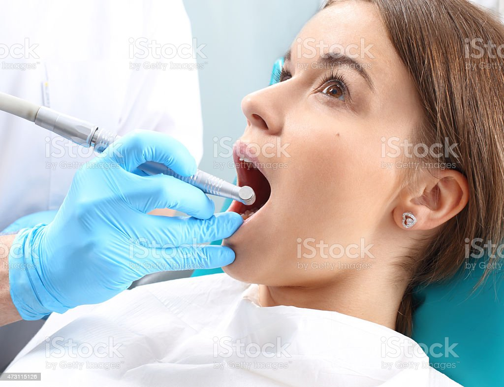 Root canal treatment, rubber separator - dental dam stock photo