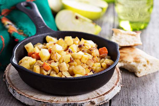 Root vegetable hash with apple stock photo