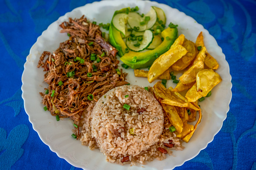 traditiona Ropa Vieja is a classic Cuban stew of shredded beef (carne mechada) served with rice, avocado and fried banana