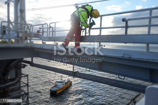 technician, offshore platform, sea vessel, sunny, rope access