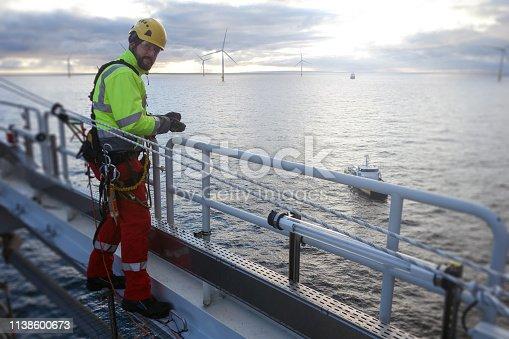 technician, offshore platform, sea vessel, sunny, rope access