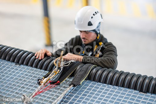 Rope access technician working in communication tower
