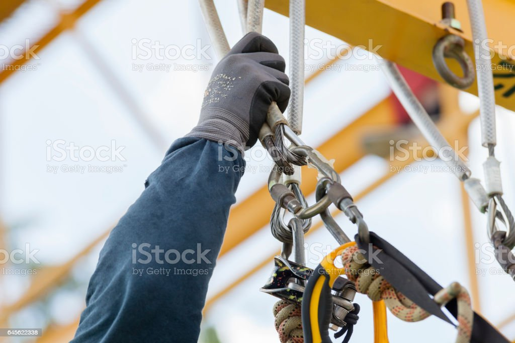 Rope access worker checking equipment royalty-free stock photo