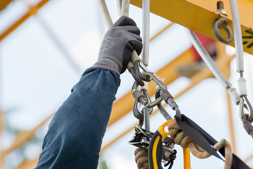 istock Rope access worker checking equipment 645622338