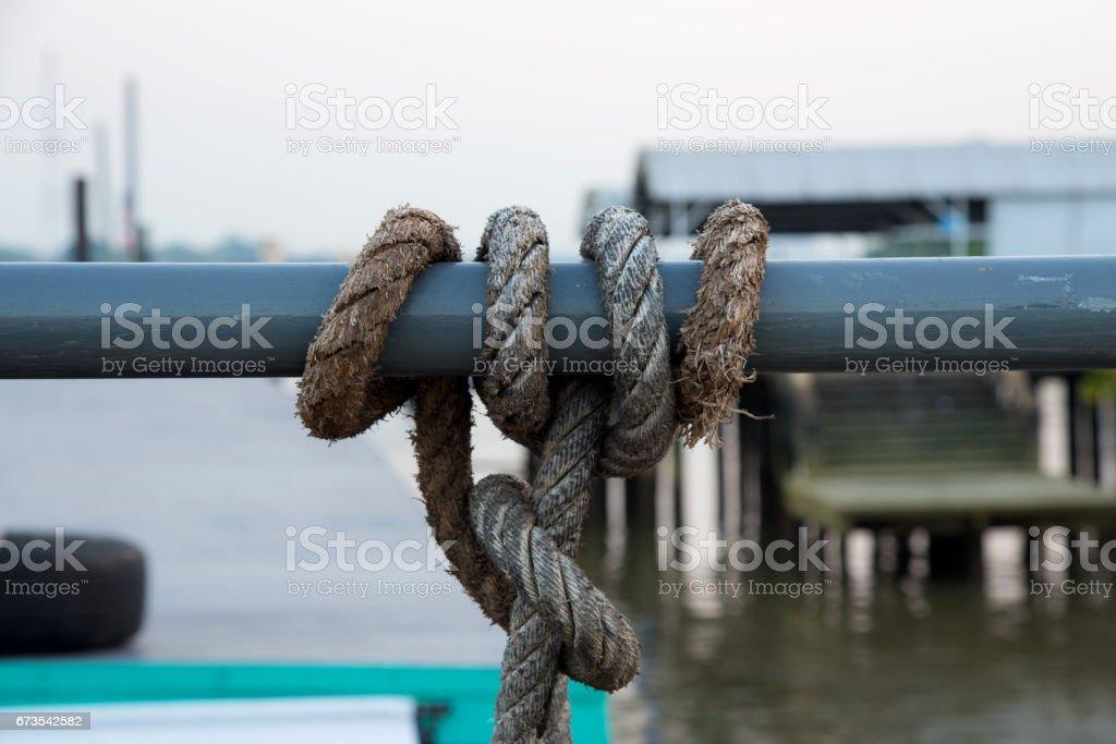 Rope across around steel tube royalty-free stock photo
