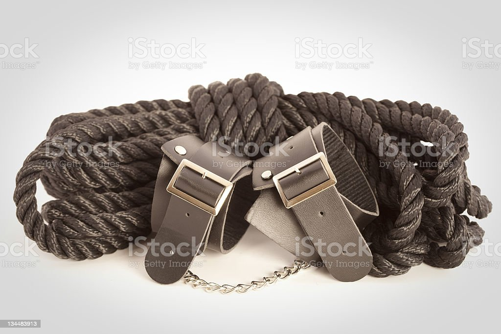 Rope and cuffs royalty-free stock photo