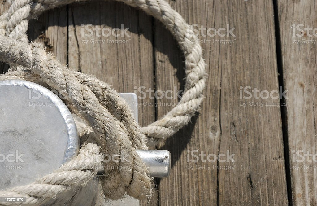 rope attach to boating dock royalty-free stock photo
