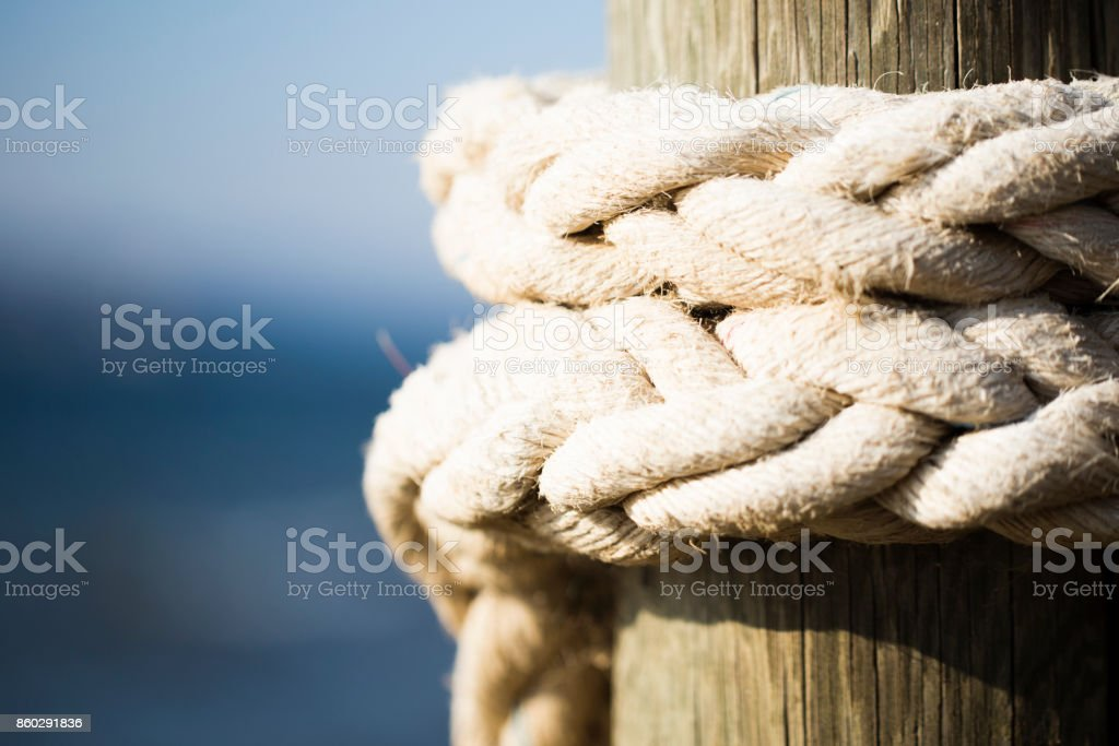 rope attached to the pier royalty-free stock photo
