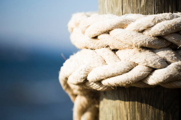 rope attached to the pier stock photo
