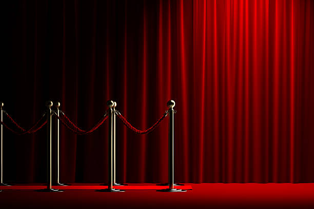 Rope barrier with red carpet and curtain Velvet red rope barrier with a shining curtain on the right upper class stock pictures, royalty-free photos & images