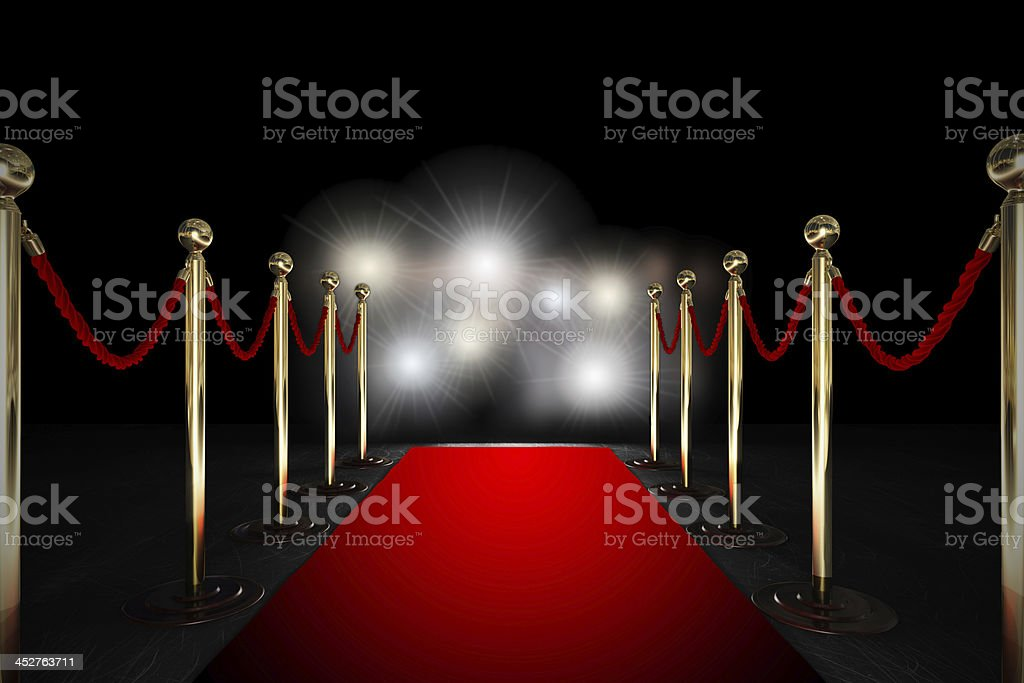 Rope barrier with red carpet and flash light stock photo