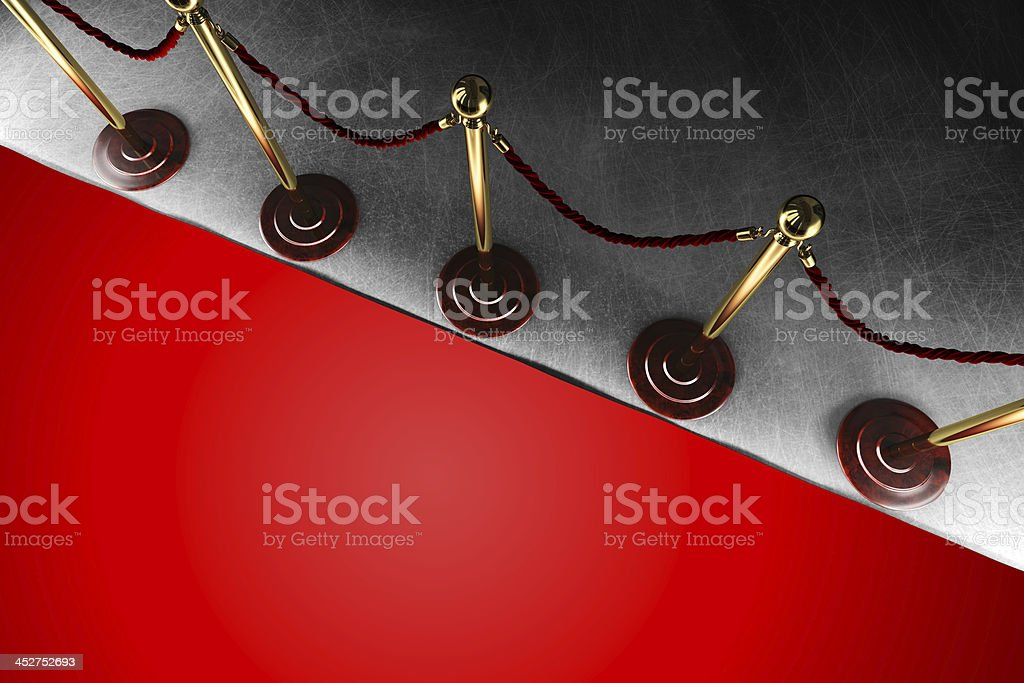 Rope barrier with red carpet stock photo
