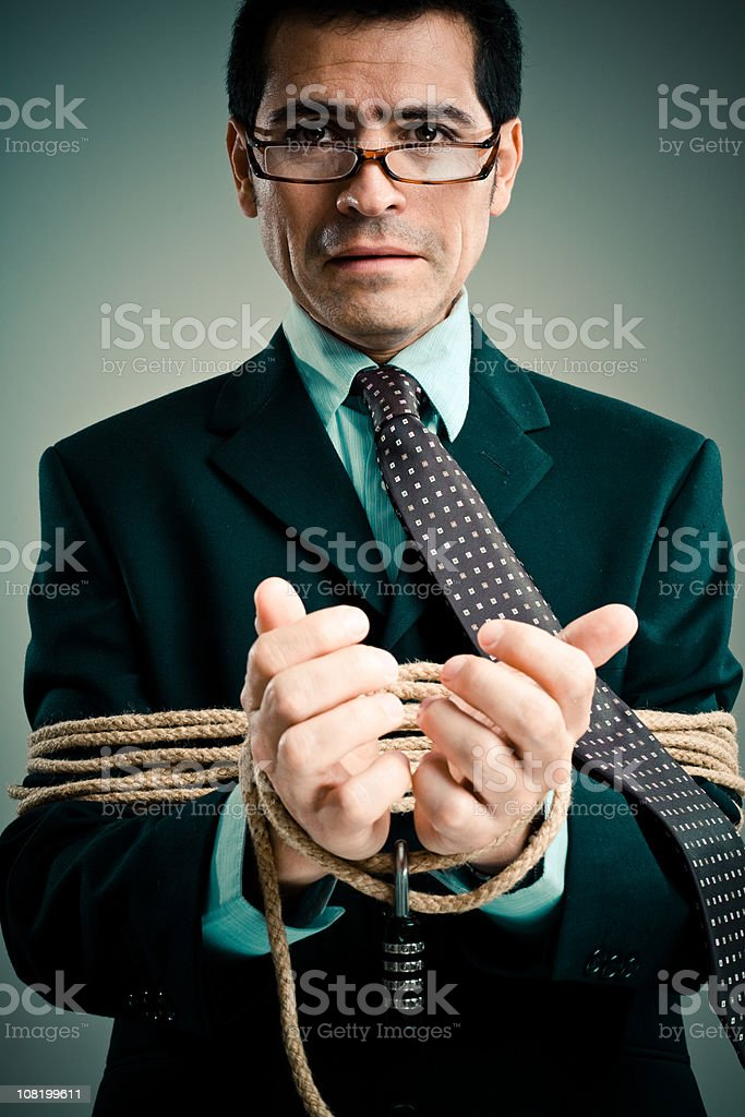 Rope Binding a Businessman's Hands royalty-free stock photo