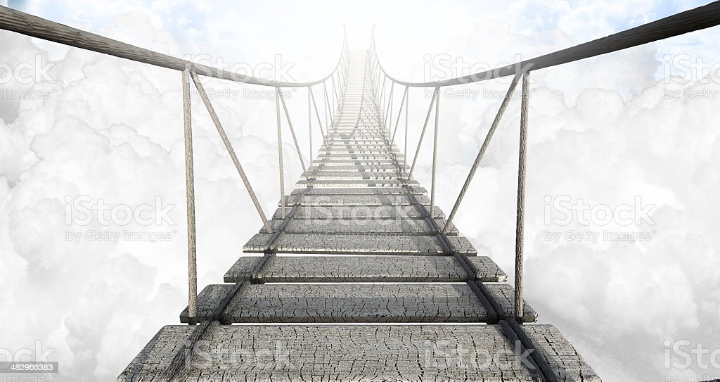 Rope Bridge Above The Clouds stock photo
