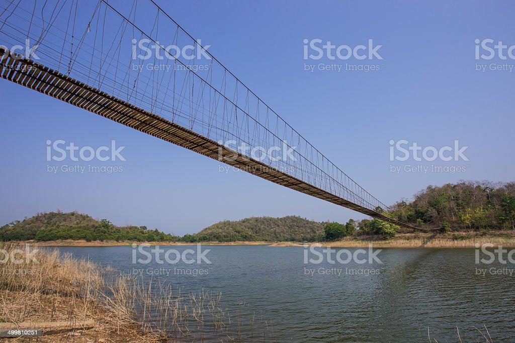 rope bridge to the island stock photo