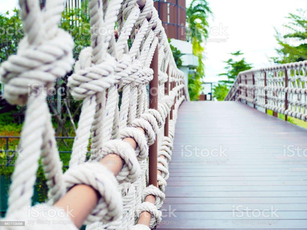 Rope bridge wood pathways to the beach. stock photo