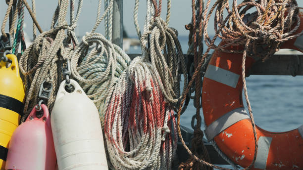rope, buoys and lifesaver nautical supplies - katiedobies stock pictures, royalty-free photos & images