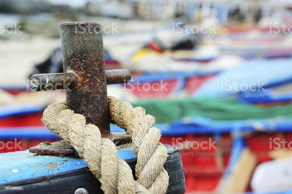 Rope in the bow/front of old fishing boat royalty-free stock photo