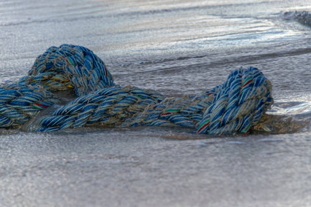 Rope in the sand stock photo
