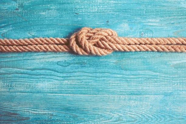 Corda, nó e fundo de madeira - foto de acervo