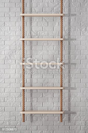istock Rope Ladder in front of Brick Wall 512508870