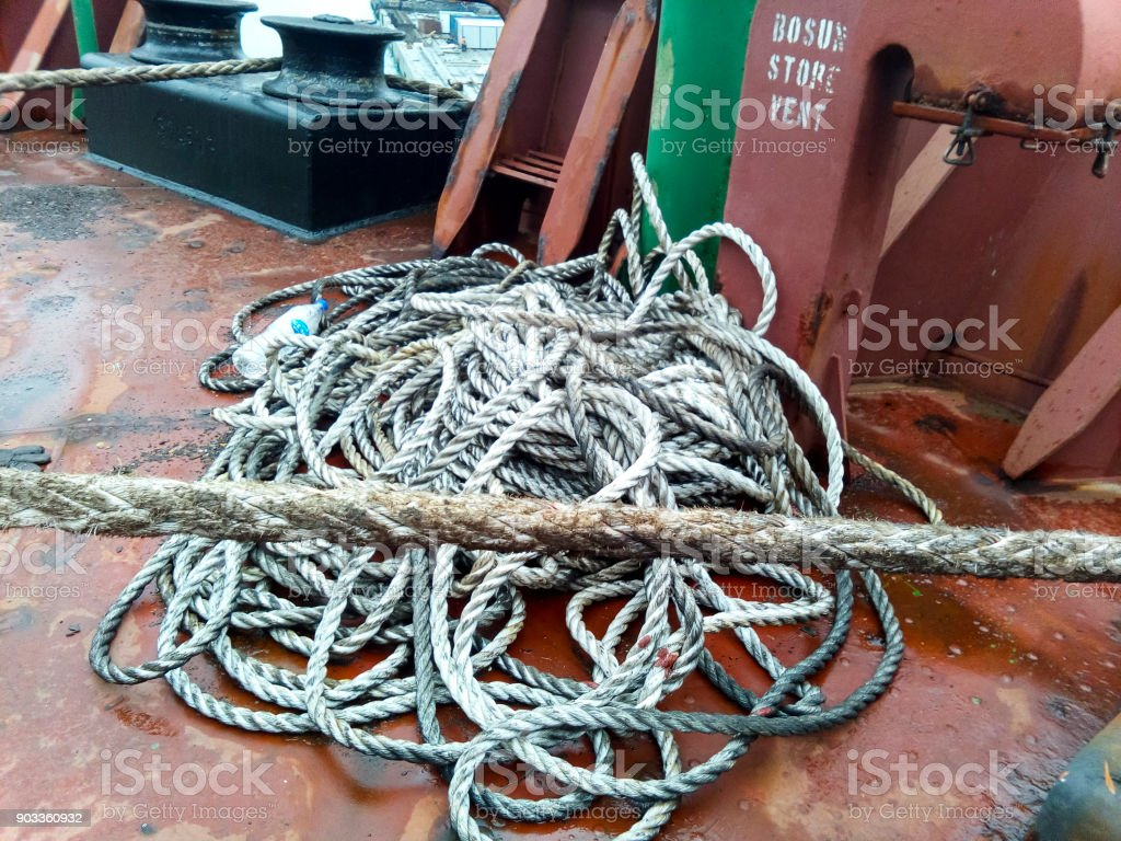 Rope ladder on the ship. Rope and wood stock photo