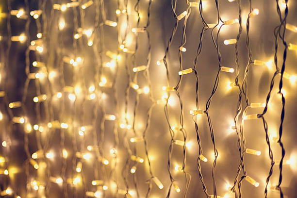 rope line abstract background with fairy lights - weihnachts led beleuchtung stock-fotos und bilder
