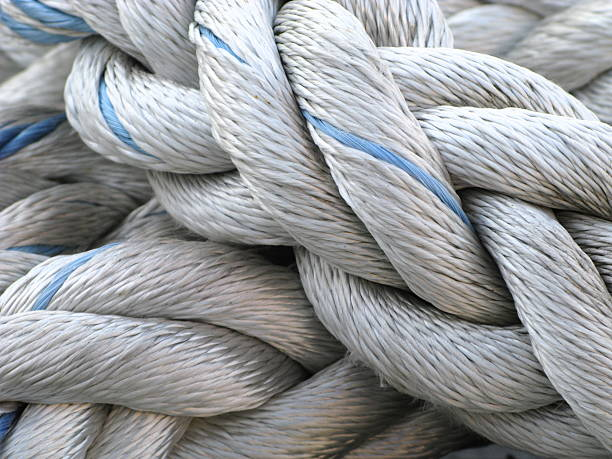 Rope Nautical Marina A close up of a knotted rope at a marina. mooring stock pictures, royalty-free photos & images