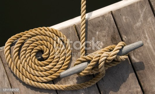 Rope tethering a boat to a dock.