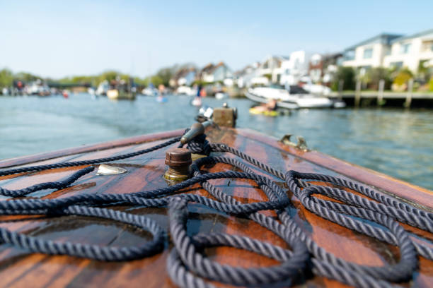 Rope on a wooden boat in Christchurch Harbour stock photo