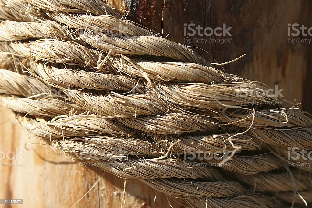 Rope on a wooden surface royalty-free stock photo