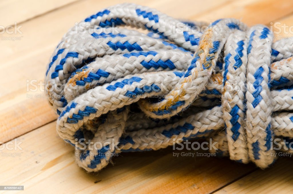rope on a wooden table stock photo