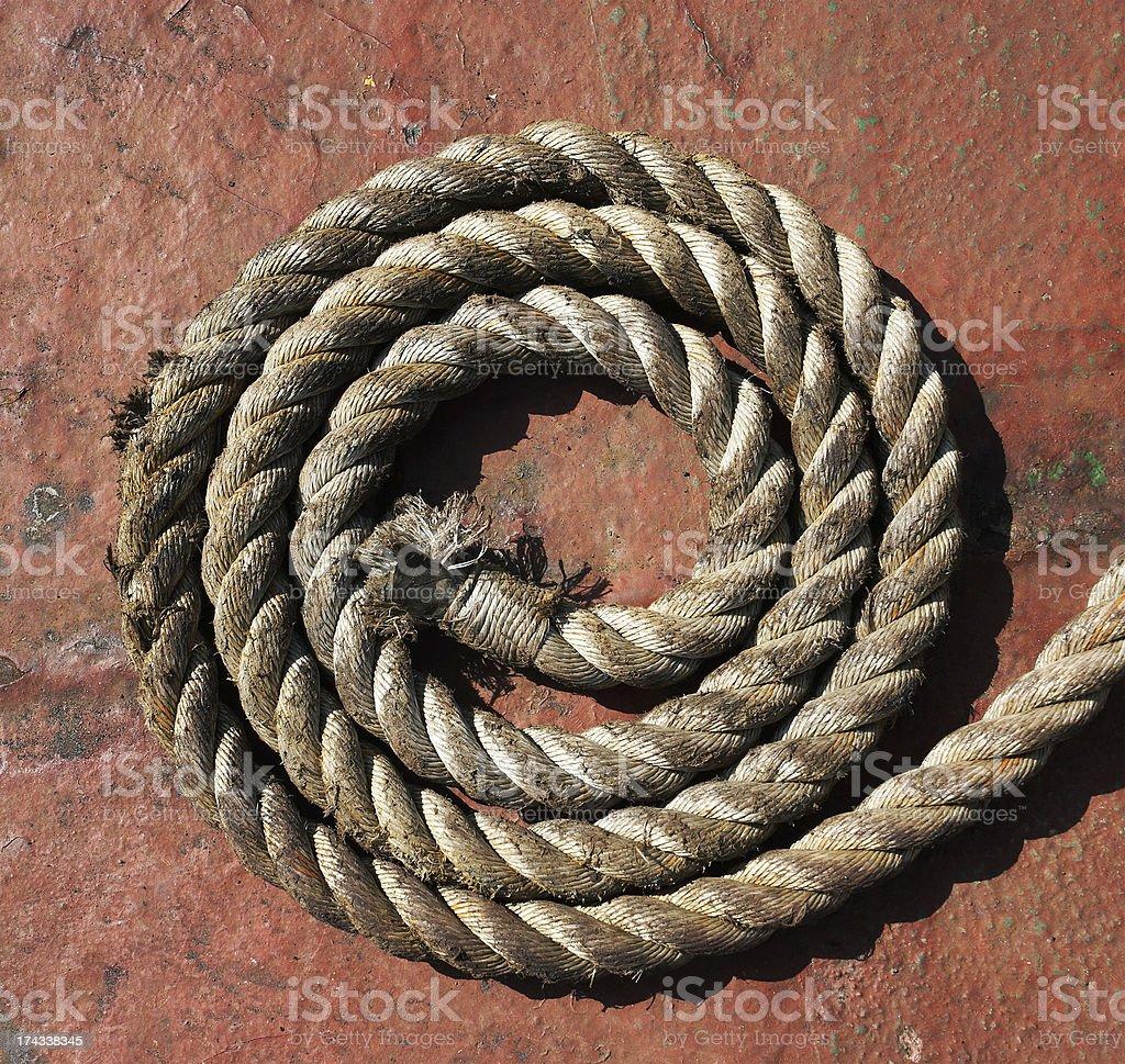 Rope on grunge metal royalty-free stock photo