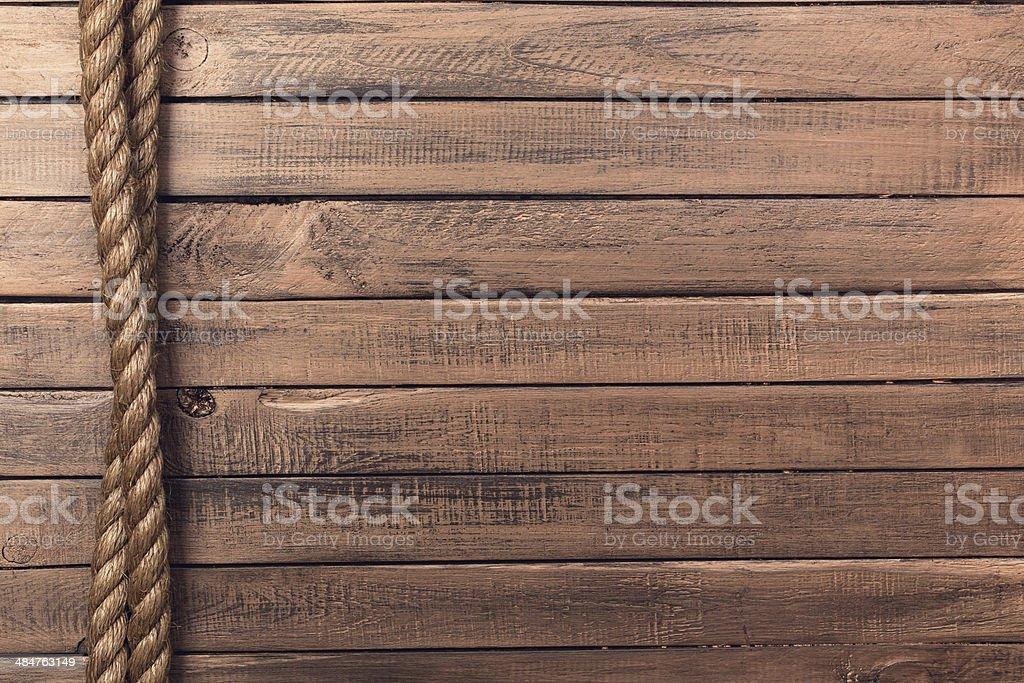 Веревки на старые деревянные доски вертикальные стоковое фото