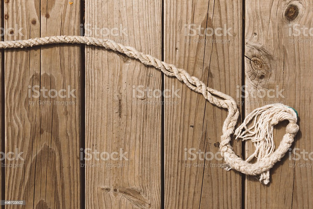 Rope on wooden background stock photo